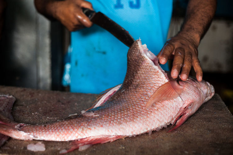 Adult Boning Fish Close-up Day Fish Fish Market Fisherman Fishermen's Life Fishing Food Food And Drink Freshness Healthy Eating Human Body Part Human Hand Indoors  Men One Person People Preparation  Real People Red Snapper Skill