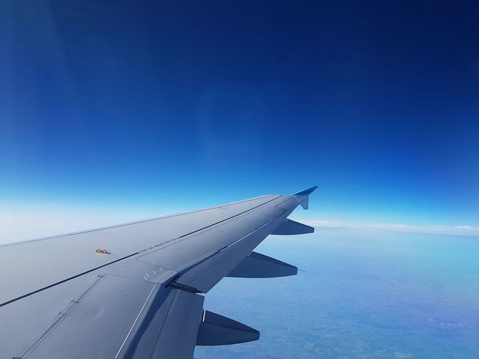 Airplane flying over blue sky