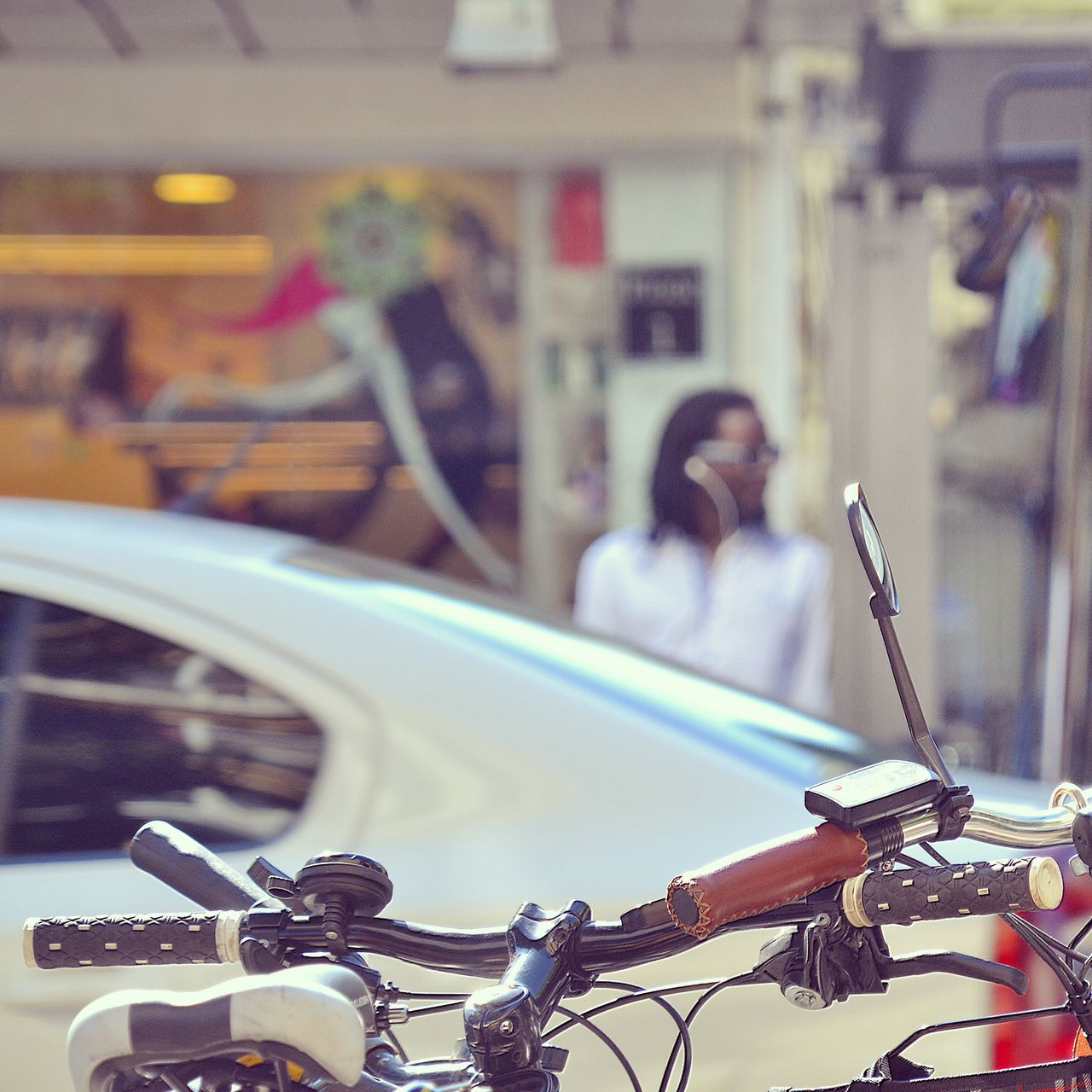 mode of transport, transportation, land vehicle, bicycle, stationary, focus on foreground, real people, lifestyles, car, motorcycle, one person, day, outdoors, city, close-up, people