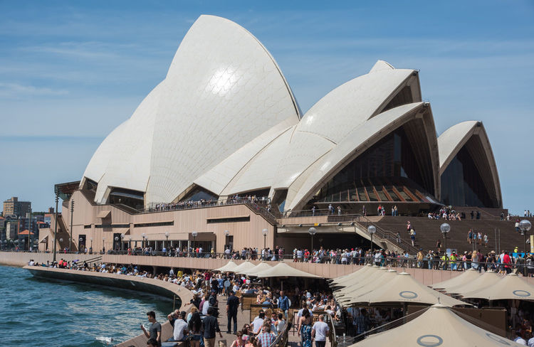 Sydney,NSW,Australia-November 20,2016: Sydney Opera House and Bar at Bennelong Point in Sydney, Australia. 20th Century Architecture Australia City Life City Break Harbour Modern Architecture Opera Bar Sydney Opera House Sydney Harbour  Tourist Bar Bennelong Point Crowd Crowded Design Large Group Of People Lifestyles Parramatta River Real People Style Sydney Tourism Umbrella Waterfront