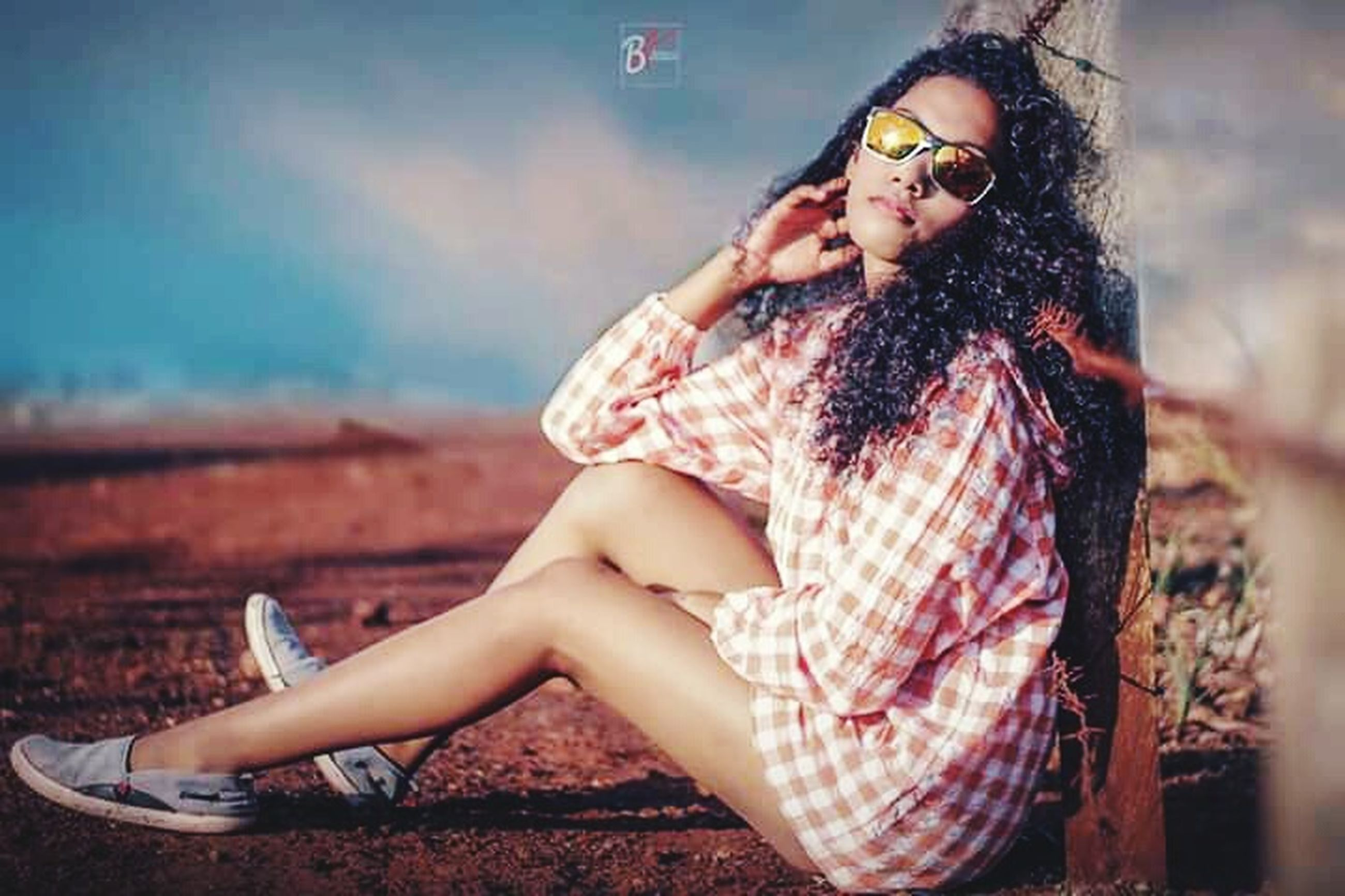 one person, fashion, young adult, sitting, full length, beauty, beautiful woman, clothing, women, adult, portrait, sunglasses, glasses, young women, nature, day, looking, looking away, hair, hairstyle, outdoors, contemplation, teenager
