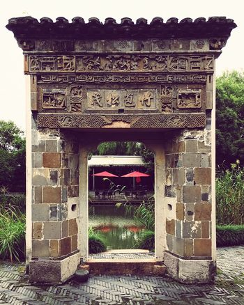 Architecture Built Structure History Travel Destinations Gate Ancient Outdoors Building Exterior Day No People Arch Tourism Tree Low Angle View Old Ruin Place Of Worship Sculpture Ancient Civilization Chinese Gate Limestone Sculptures 西溪度假酒店餐厅