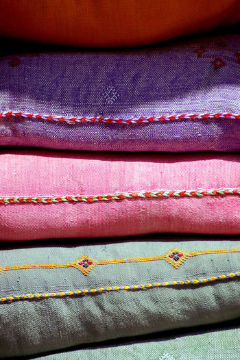 Colors Morocco Backgrounds Blue Close-up Clothing Denim Fashion Full Frame Garment Indoors  Linen Multi Colored No People Pattern Pillows Pink Color Purple Still Life Striped Textile Textile Industry Textured