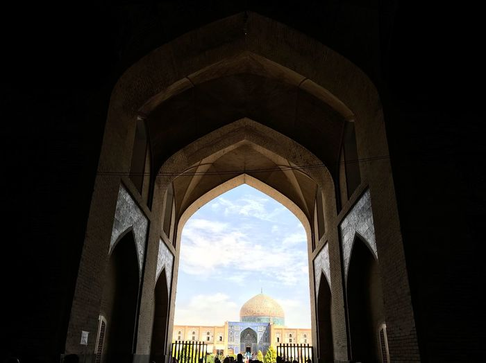 Ali Qapu (Persian: عالی قاپو, 'Ālī Qāpū) is a grand palace in Isfahan, Iran. It is located on the western side of the Naqsh e Jahan Square, opposite to Sheikh Lotfollah Mosque, and had been originally designed as a vast portal. It is forty-eight meters high and there are six floors, each accessible by a difficult spiral staircase. In the sixth floor, Music Hall, deep circular niches are found in the walls, having not only aesthetic value, but also acoustic. Inside bazaar view Go Higher Stories From The City The Architect - 2018 EyeEm Awards EyeEmNewHere The Art Of Street Photography The Mobile Photographer - 2019 EyeEm Awards
