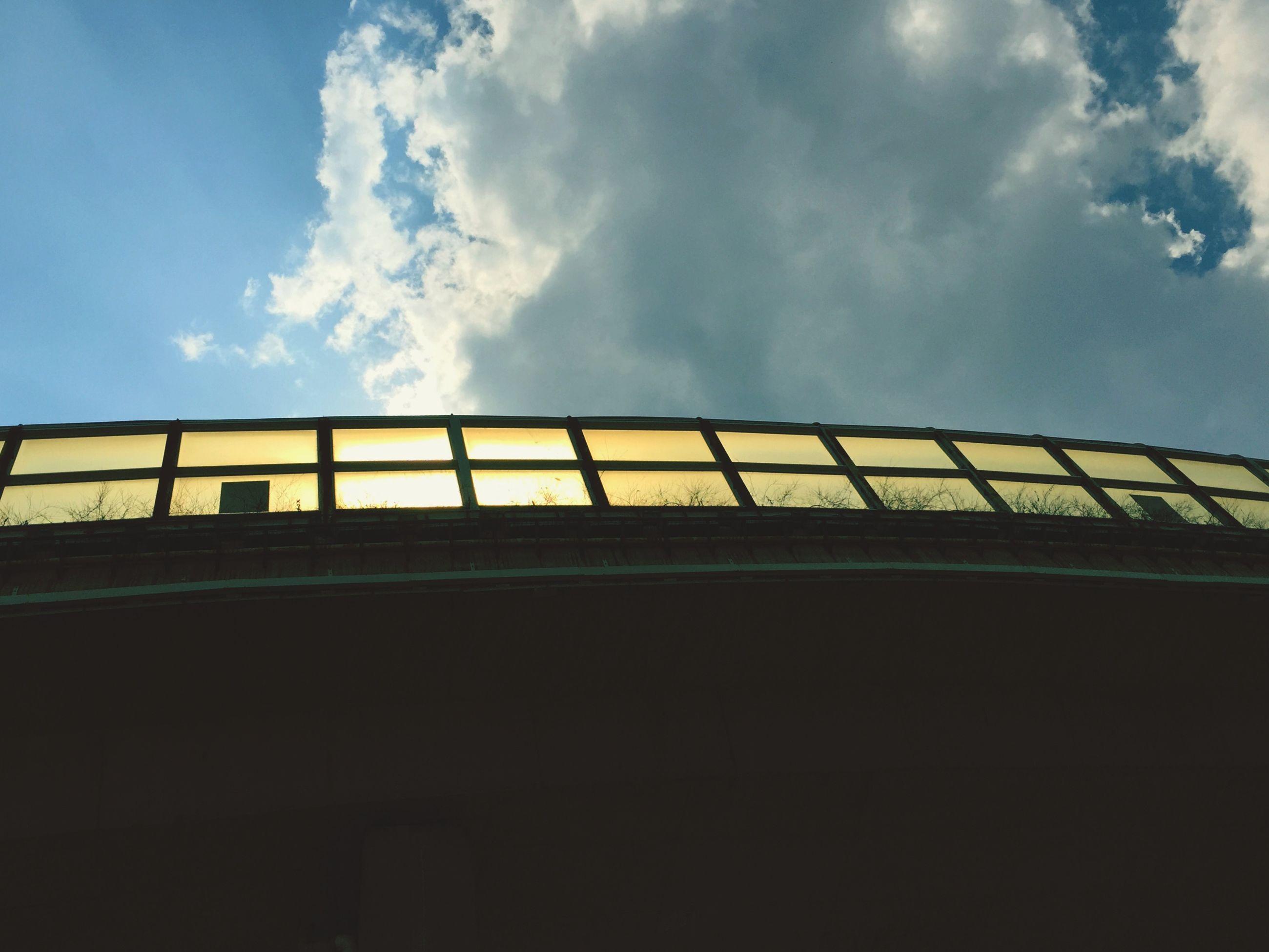 sky, low angle view, built structure, connection, architecture, cloud - sky, bridge - man made structure, transportation, railing, cloud, silhouette, bridge, outdoors, no people, cloudy, engineering, sunset, dusk, building exterior, nature