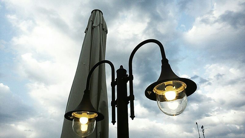 Street Lamps Glitter & Sparkle Light Up Your Life Bulbs Effect Storm Cloud Overcast Old-fashioned Low Angle View Overview Looking Up Cloudy Afternoon Atmosphere Light Snap Everywhere Sky Umbrellastreet Dreamer's Vision Eyeem Market Casualphotography Outdoors EyeEmNewHere Welcome To Black