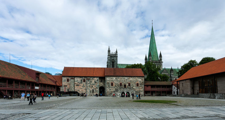 Urban landscape in Norway,Trondheim Cathedral Cityscape Nidaros Cathedral Nidarosdomen Norway Travel Trondheim Architecture Belief Building Building Exterior Built Structure Cathedrale City Cityscape Photography Cloud - Sky Group Of People History Nature Nidaros Nidaros Cathedral Norway Nature Outdoors Place Of Worship Religion Sky Spire  Spirituality Street Tower Travel Destinations