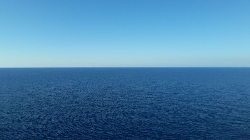 Blue Copy Space Sea Nature Beauty In Nature Clear Sky Scenics Water Textured  Horizon Over Water Sparse Outdoors No People Backgrounds Tranquil Scene Sky Day Horizon Close-up Light Blue Sky Cruising Cruise Ship Light Blue Blue