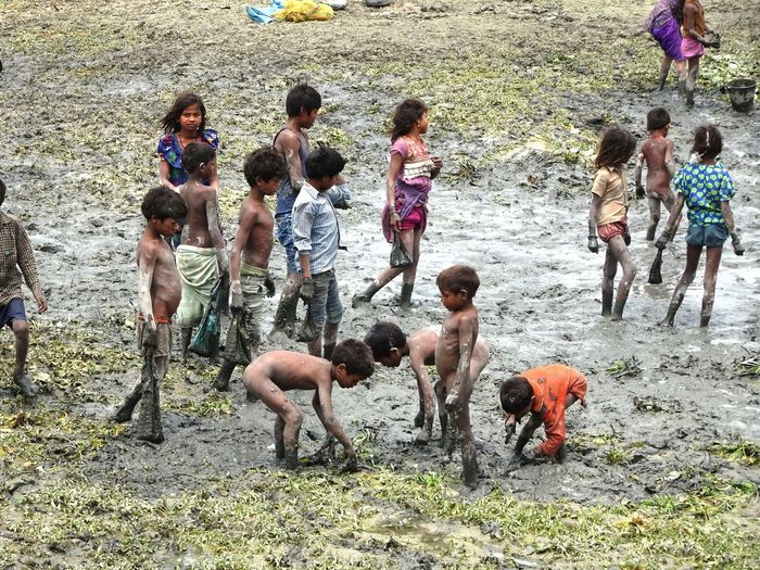 CATCHING FISH IN MUD Day Nature Outdoors People Poor Kids Rural Scene Togetherness Break The Mold The Photojournalist - 2017 EyeEm Awards The Street Photographer - 2017 EyeEm Awards The Great Outdoors - 2017 EyeEm Awards Live For The Story