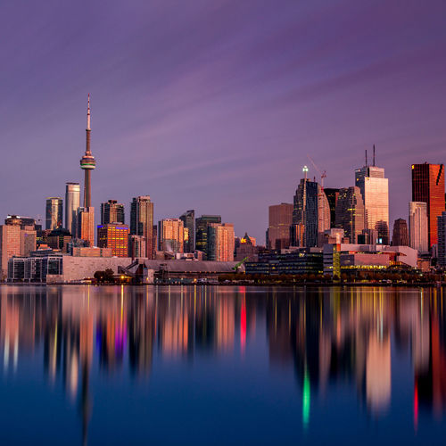 Reflections of a city. Cityscapes Long Exposure Jasoncrockettphotography Water Reflections Buildings Architecture Amazing Architecture Water Downtown Toronto Cntower