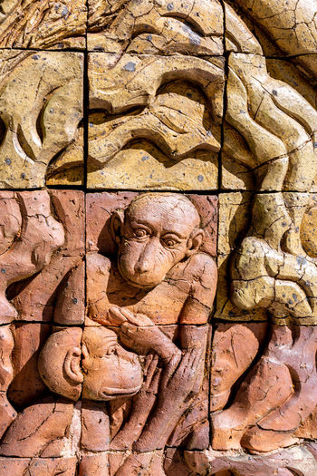 Bas-relief in Thailand. Art And Craft Sculpture Craft Representation Statue History The Past Carving - Craft Product Ancient No People Human Representation Architecture Ancient Civilization Art Culture Buddhist Stone Wall Wall Ancient Architecture