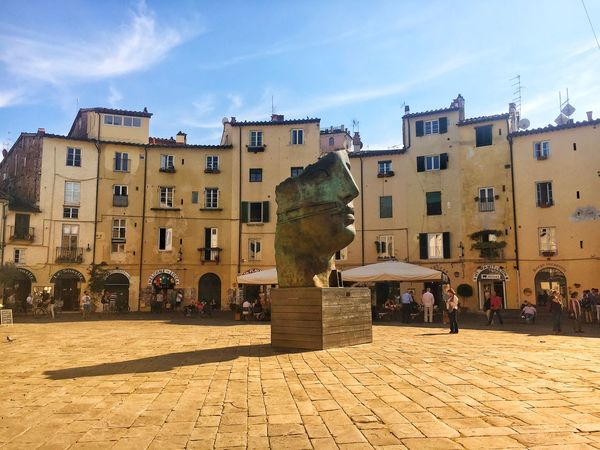 Lucca • piazza Anfiteatro • Architecture Building Exterior Built Structure Sky Incidental People Cloud - Sky Day Sunlight Outdoors Travel Destinations Large Group Of People Real People Men City People Lucca Italy Mitoraj Art Is Everywhere Mitoraj