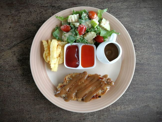 Steak Pork Salad Testy Sauce PlateLunch Grilled Dinner Hot Vegetable French Fries Healthy Eating Indoors  TableReady-to-eat Close-up Tomato Beef Chicken Wood Wooden Dish