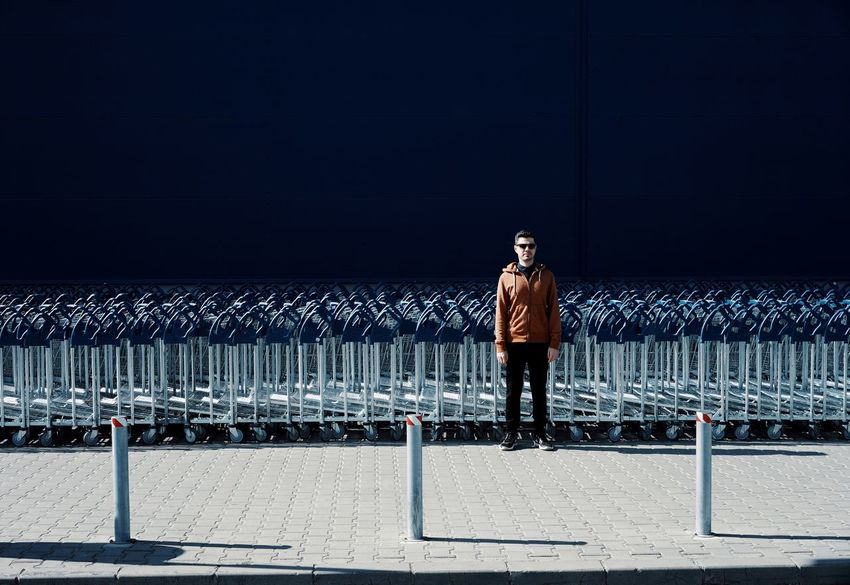 Abundance Blue Light And Shadow One Person One Man Only People Real People Shopping Cart Shopping Carts Full Length Standing Men