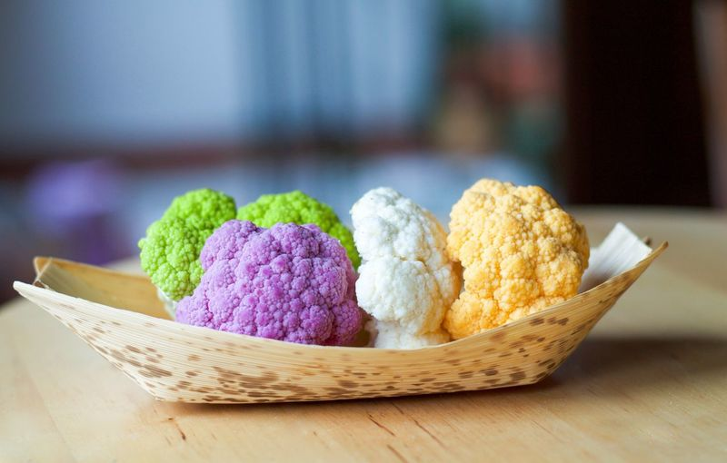 Close-Up Of Colorful Cauliflowers On Table