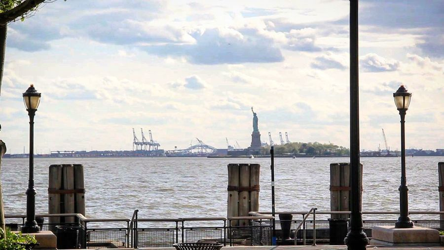Sky Water Day Sea Cloud - Sky No People Street Light Outdoors Built Structure Architecture Transportation City Nature Travel Destinations Beauty In Nature New York City New York Statue Of Liberty Statue