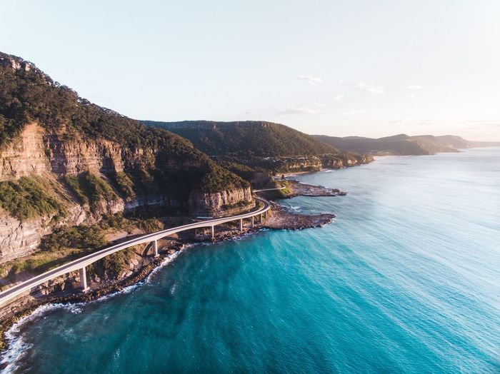 Mountain Scenics Water Beauty In Nature Tranquil Scene Nature Idyllic Tranquility Sea Mountain Range No People Outdoors Day Landscape Sky Cliffs Bridge The Drive