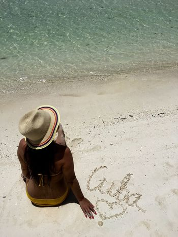 Beach Beach Day Beach Photography Beach Time Beauty In Nature Cuba Full Length Hat Holiday Hot Day Nature Ocean One Person Outdoors Sand Sea Seaside Sitting Summer Sun Hat Sunlight Vacations Water Women Writing On The Sand
