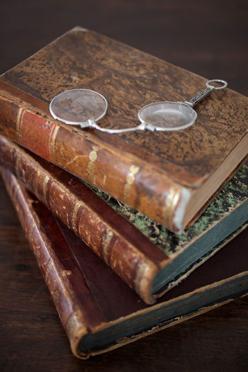 old books piled on a wooden table Antique Books Bookshelf Bookshelfs Learning Library Read Reading Book Brown Close Up Close-up Collection Cover Culture Indoors  Leather No People Old Piled Reading A Book Table Traditional Vertical Wood - Material