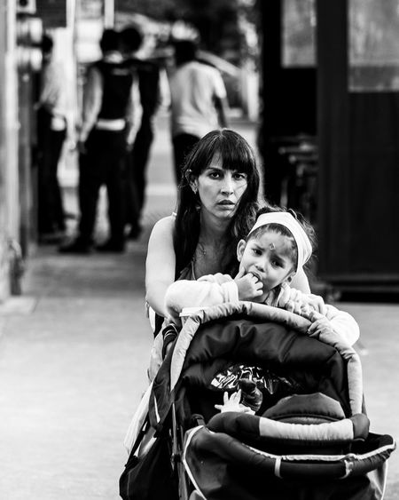 Read about the camera I used to take this photo here: https://trovatten.com/camera/fujifilm-x-t3/ Street Photography Streetphotography Black And White Black And White Photography Fujifilm Fujifilm_xseries People Woman Mom Mother & Daughter Family Streetphoto_bw Street Public Stroller WeekOnEyeEm EyeEm Best Shots Women Real People Child Looking At Camera Childhood Daughter Love Focus On Foreground Portrait