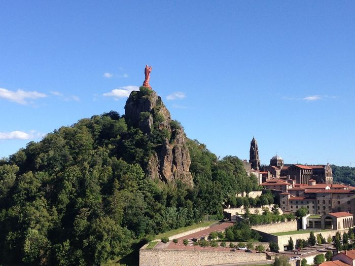 Our Lady of Le Puy Architecture Blue Building Exterior Built Structure Clear Sky Cloud Day Famous Place Hill History House Incidental People Low Angle View Mountain Our Lady Our Lady Of Le Puy Rock - Object Rock Formation Sky Sunlight Travel Destinations Tree