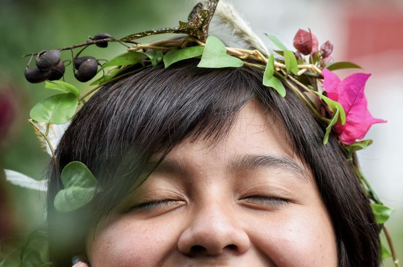 Close-up portrait of girl with flowers