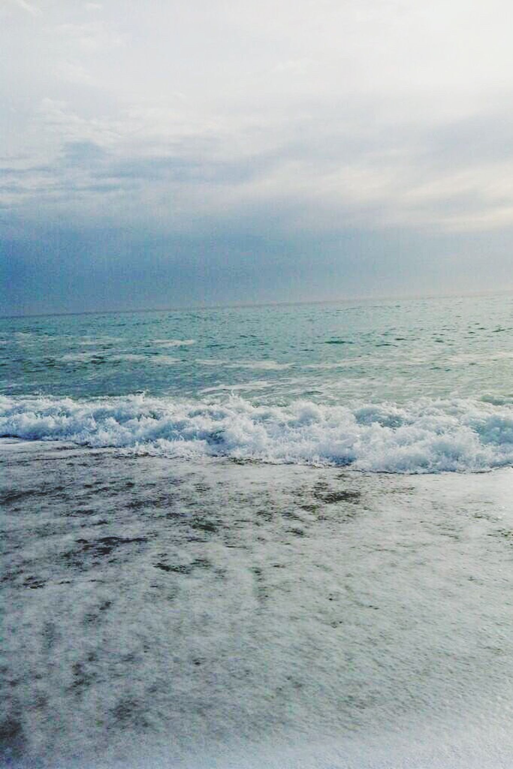 sea, sky, horizon over water, water, scenics, tranquil scene, tranquility, beauty in nature, beach, cloud - sky, nature, weather, cloudy, shore, wave, idyllic, cloud, surf, remote, overcast