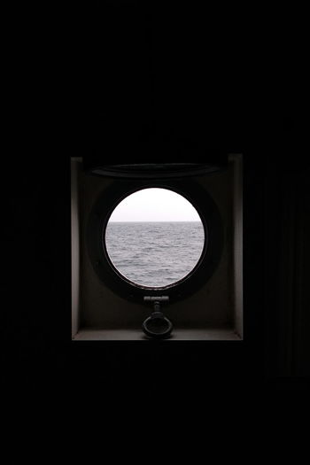Close-up of window over black background