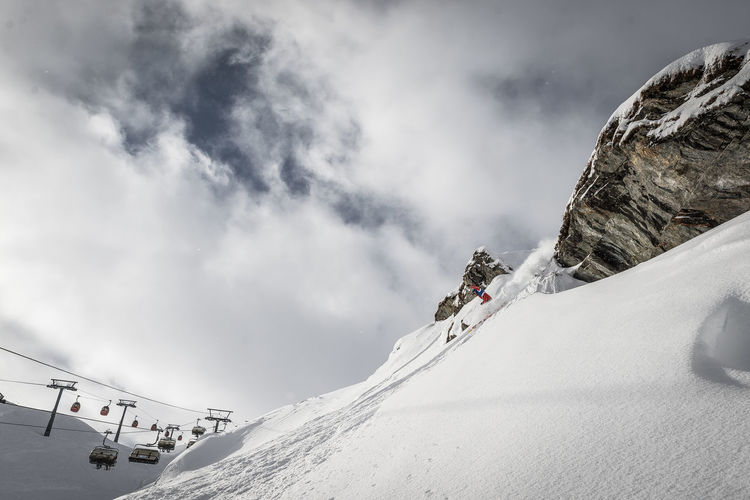 Winter Snow Cold Temperature Sport Adventure Mountain Leisure Activity Cloud - Sky Winter Sport Beauty In Nature Scenics - Nature Vacations Trip Snowcapped Mountain Real People Holiday Day Extreme Sports One Person Mountain Range Outdoors