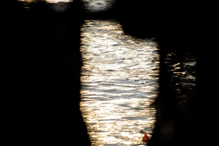 View of sea through silhouette window
