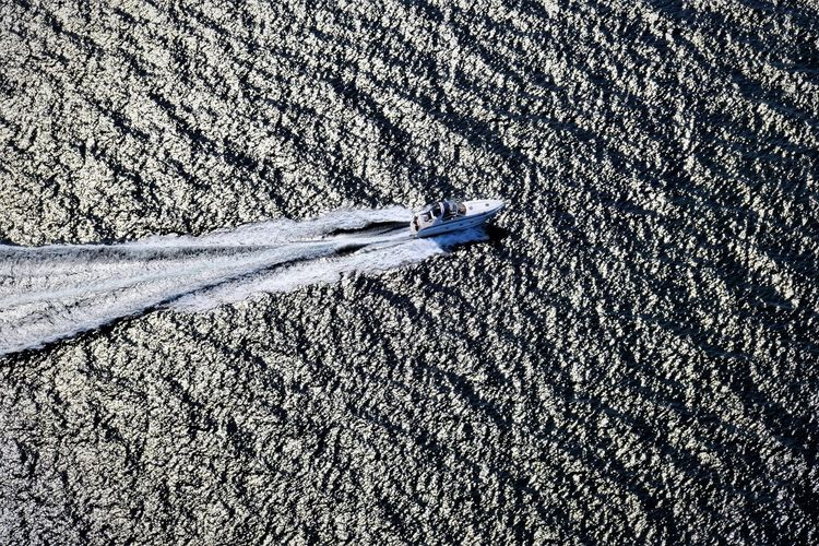 Aerial View Of Motorboat Sailing In Sea