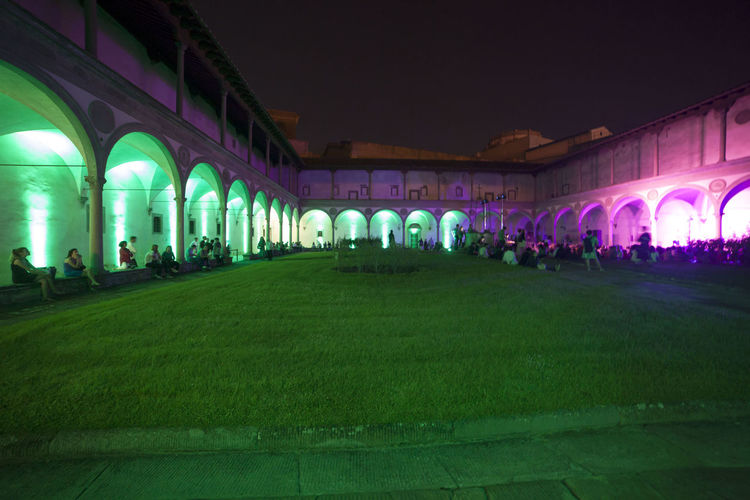 Florence, Santa Croce church and cloister. Arch Architectural Column Architecture Building Building Exterior Built Structure City Crowd Grass Group Of People History Illuminated Large Group Of People Lighting Equipment Nature Night Outdoors Real People Sky Travel Travel Destinations