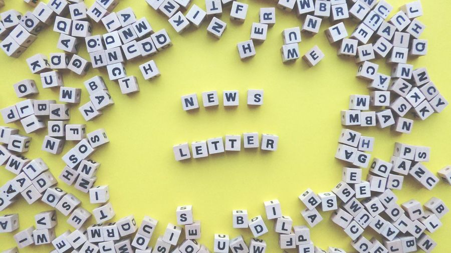 Wooden dice and letters News Letters Blog Marketing Yellow Background Communication Yellow Full Frame Text Close-up Written Single Word Letter E Information Alphabet Signboard Western Script Handwriting  Commercial Sign Board Typescript Short Phrase Note Spelling
