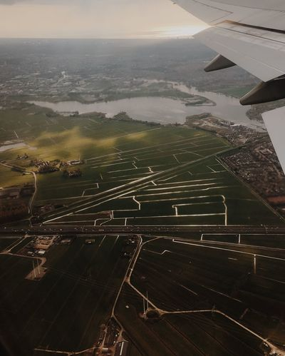 Aerial View Landscape Agriculture Nature Scenics Patchwork Landscape Tranquil Scene Beauty In Nature Canal High Angle View Day No People Outdoors Tranquility Transportation Airplane Rural Scene Flying Water Sky Amsterdam Schipol  Netherlands Europe Golden Hour The Great Outdoors - 2017 EyeEm Awards