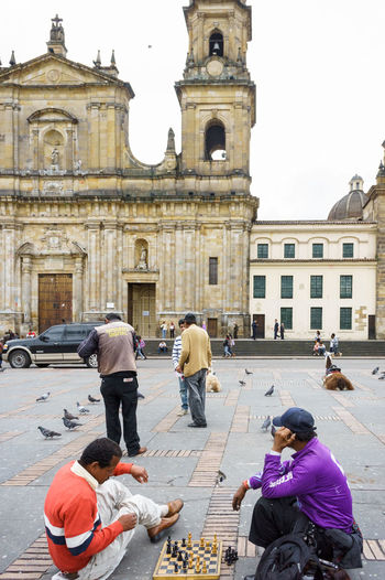 Men are playing chess in Bogota's main square. Colombia. Check This Out Colombia Adult Architecture Building Building Exterior Built Structure Chess Chess Piece Chessgame Day Group Of People Lifestyles Men Outdoors Playing Real People This Is Aging