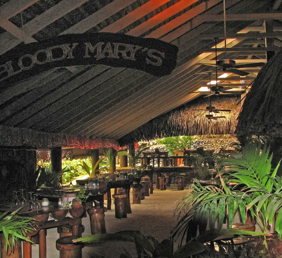 The interior of the famous Bloody Mary's bar restaurant on the island of Bora Bora, French Polynesia Bloody Mary's Bora Bora  French Polynesia Architecture Awning Bar Built Structure Illuminated Indoors  Night No People Restarant And Bar Roof Text