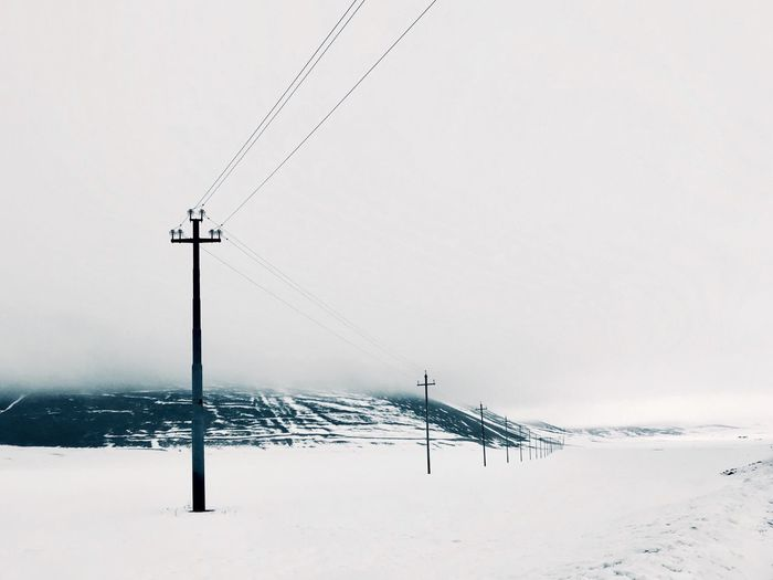 EyeEm Selects Snow Winter Sky Cold Temperature Nature No People Environment Technology Connection Cable Frozen Electricity  Humanity Meets Technology