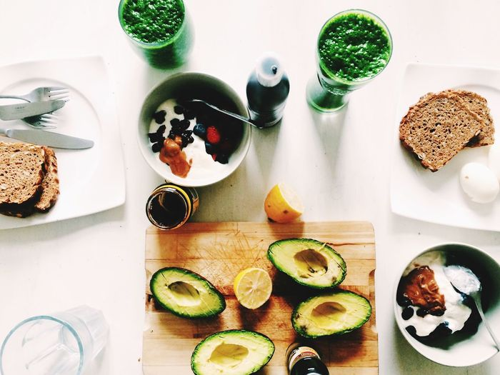 High Angle View Of Avocado And Breakfast In Table