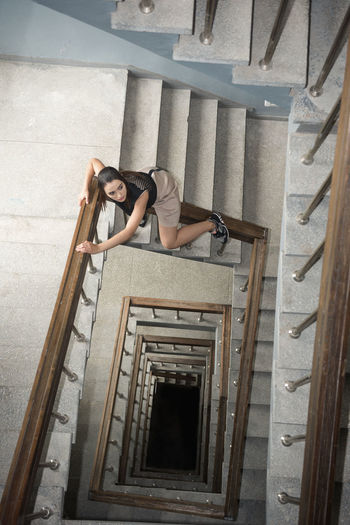 High angle view of woman at staircase