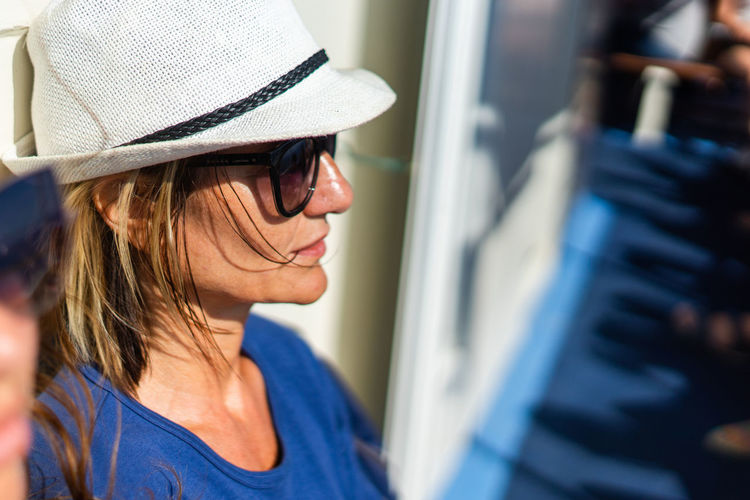 Close-up of woman wearing hat in boat