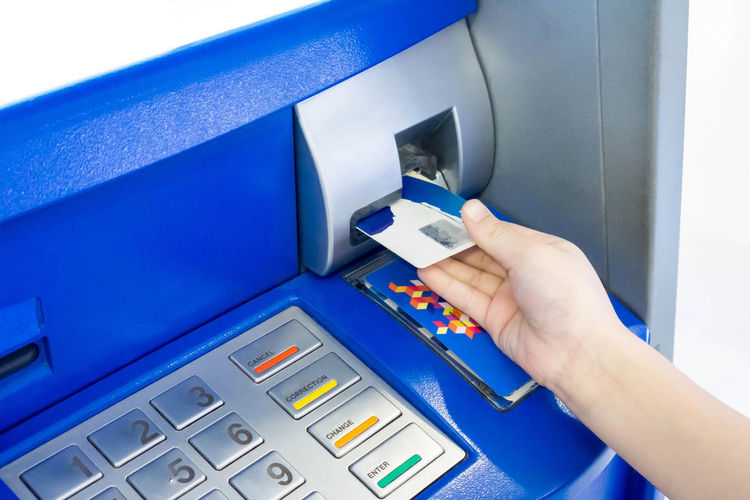 Hand of a kid using an ATM. Kid using an atm machine. Economy Bank Business Finance And Industry Car Cash Close-up Day Deposit Hand Human Body Part Human Hand Machinery Money One Person Online  Outdoors Password People Pin Real People Technology