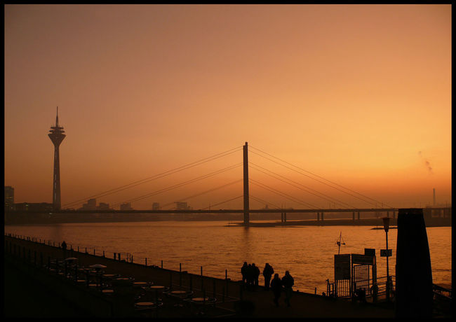 Architecture Bridge Bridge - Man Made Structure Building Exterior Built Structure City Clear Sky Connection Group Of People Nature Orange Color Outdoors Real People Sea Silhouette Sky Sunset Transportation Travel Destinations Water