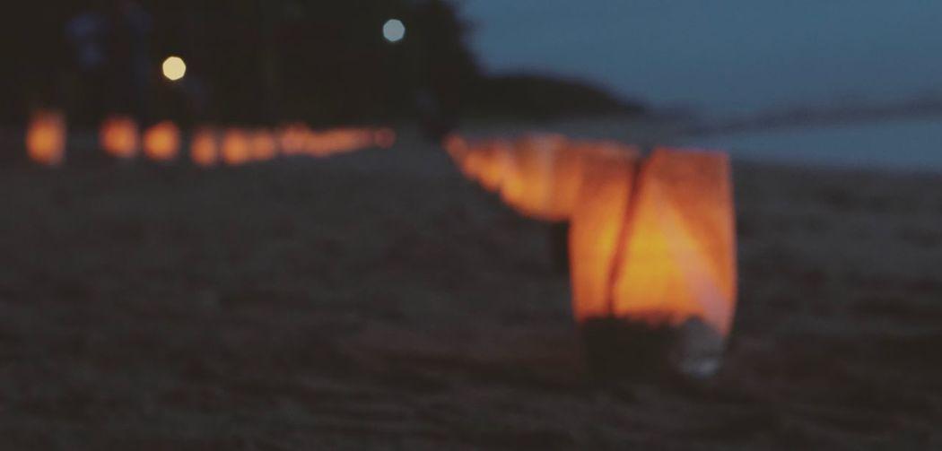 Close-up of illuminated lights at sunset