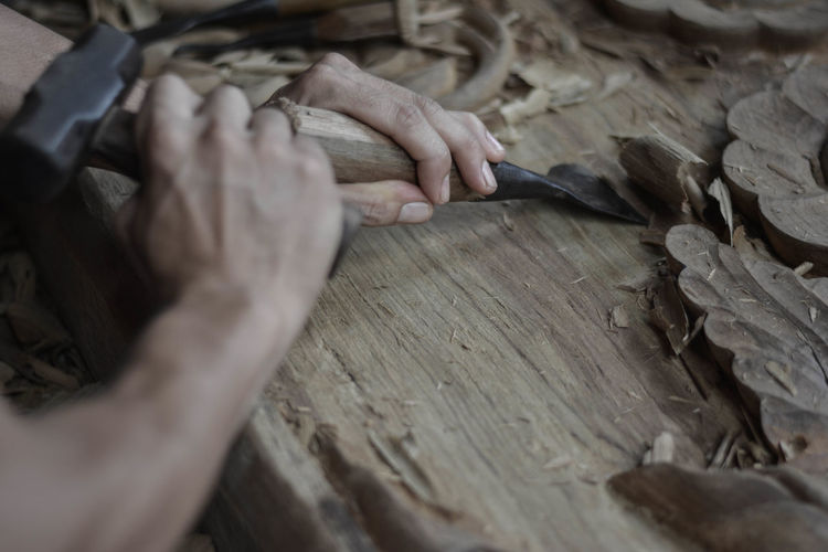 Art Wood 07 Art And Craft Craft Craftsperson Creativity Finger Hand High Angle View Holding Human Body Part Human Hand Indoors  Occupation One Person Real People Selective Focus Skill  Unrecognizable Person Wood - Material Work Tool Working