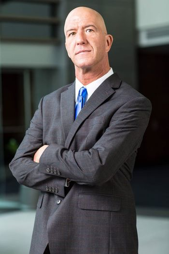Portrait Of Businessman With Arms Crossed Standing In Office