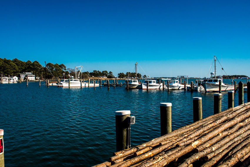 Architecture Beauty In Nature Blue Building Exterior Built Structure Chesapeake Bay Clear Sky Cufotos Day Harbor Jetty Maryland Moored Nature Nautical Vessel Nikon Nikonphotography No People Outdoors Pier Sea Sky Tranquility Water Wooden Post