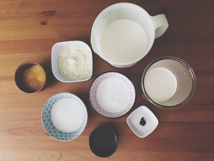 Directly above shot of vanilla ice cream ingredients on table
