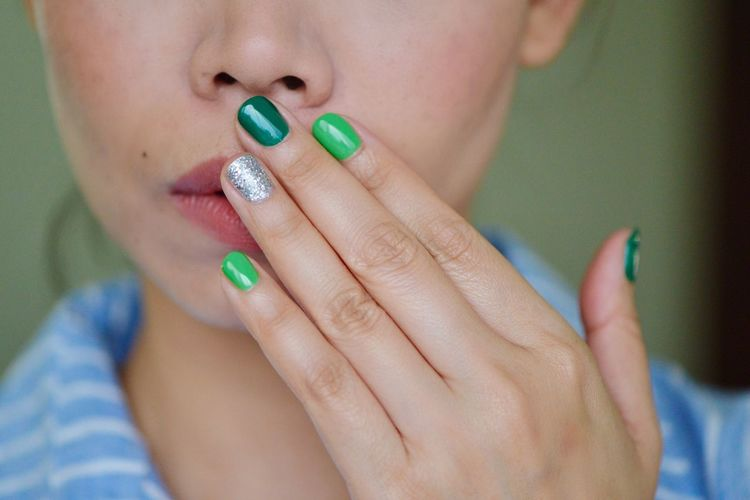 Close-Up Of Woman With Colorful Nails