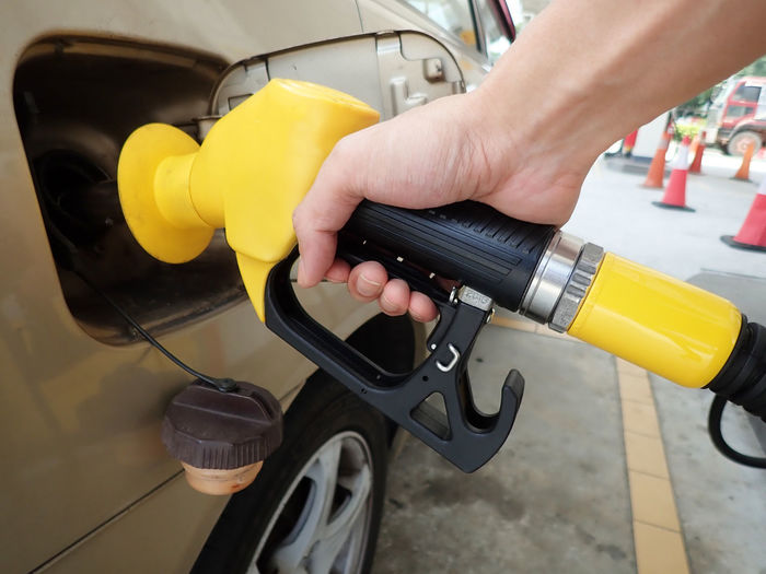 Refuelling vehicle at petrol station Petrol Gas Vehicle Fuel Transport Transportation Price Pump Station Refueling Oil