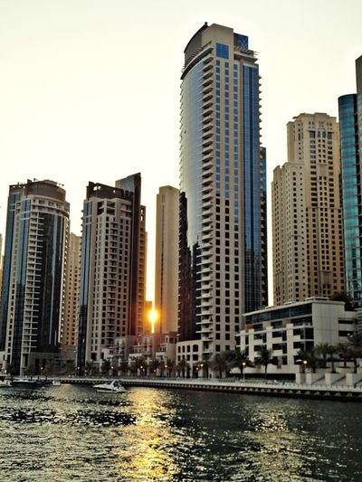 Architecture Skyscraper Business Finance And Industry Modern City Cityscape Urban Skyline Outdoors Travel Destinations Building Exterior Apartment Water Sky Downtown District Landscape Consumerism Built Structure Luxury Day Beach Dubaimarina Dubai Architecture Reflection Sun Down Sky
